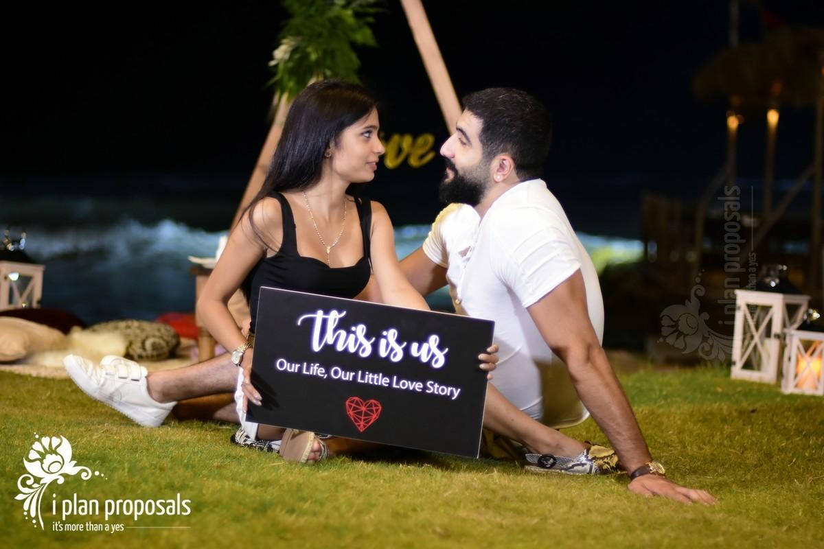 romantic beach proposal moment